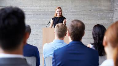 conference-speaker-talking_3a7decf0a1